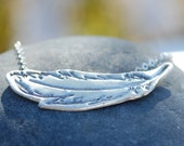 Delicate Bohemian Hand-carved Feather Triangle necklace artisan handcrafted by Chocolate and Steel