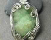 Prehnite Crystal Necklace with Silver Swirling Wire Wrap