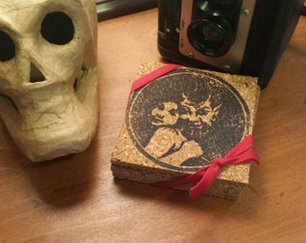 Devil with Girl block print coasters