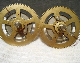 Two (2) spring gears from a grandfather clock
