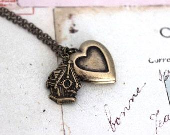 birdhouse.  heart locket necklace. brass ox swallow