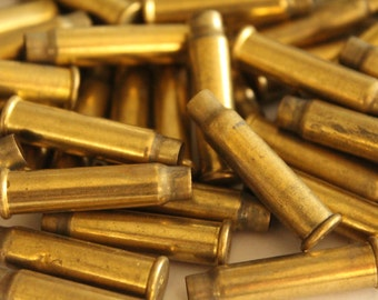 Empty brass bullet shell casings - 27x7mm - 4mm opening (12)