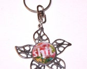 """floral star keychain what says """"sh*t"""""""