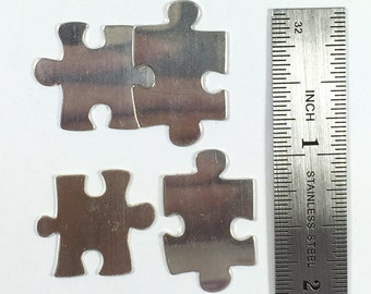 "Puzzle pair sets, 2 in 22 gauge sterling. Fit together puzzle pieces silver 3/4 "" X 7/8 "" and 1 "" X 5/8 "",  2 set pack"