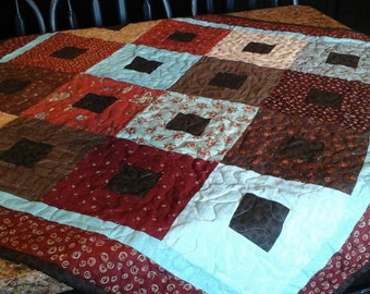 red, turquoise table topper quilt