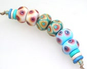 Handmade Lampwork Beads - Windjammer! 3 pairs. Dot reactions on vanilla, copper green, sky bue.