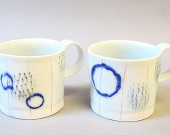 two porcelain espresso cups with translucent bottom
