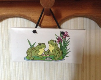 Ceramic Plaque  it is 3 by 6  With frogs