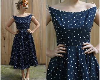 Vintage 50s Navy Blue and White Polka Dot Swing Dress with Full Skirt and Bow Tie Shoulders  | Medium