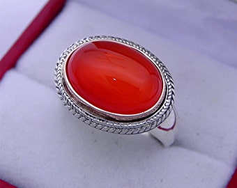 AAA Carnelian Cabochon 14x10mm 5.32 Carats in 18K Rose gold and Sterling silver ring.  1556