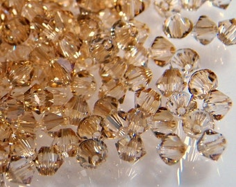 Swarovski Golden Shadow 4mm Faceted Crystal Bicone Beads (24)