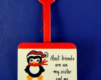 0005 Penguin on shovel. Free shipping. Message shown is a suggestion. Ornaments can be written with a message/name/date of your choice.