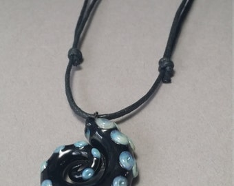 Black Tentacle Pendant with suction cups on a black cord for guys or gals or silver chain