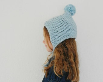 Pixie Bonnet with Pom Pom Hand Knitted in Pale Blue Kids Winter Fashion Accessories