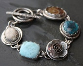 turquoise, ammonite, larimar, sea biscuit and sterling silver metalwork link bracelet