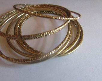 9 gold bangles