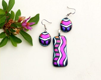 Fused dichroic glass pendant and earring set, pink and silver wiggles on black