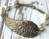 FREE shipping. Antiqued Brass Wing Bracelet - Your choice Swarovski Pearl color. Hand-linked pearls. Angel. Bird Wing Feather