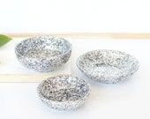 Trio set of three.One large,one medium and one small resin salt and pepper spice pinch trinket dish bowls in silver glitter sparkle.