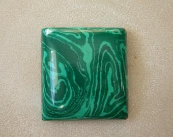 A wonderful 'pillow'-cut cabochon of Malachite