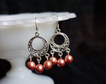 Chandelier earrings with pink faux-pearls