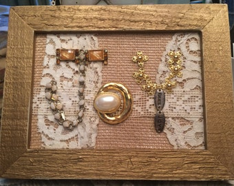 "JOY spelled out in Vintage Jewelry on Old Lace and Burlap in a Gold Hard Wood Cypress 5"" x 7"" Frame"