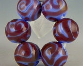 a set of 6 rounds done in opaque periwinkle blue with dark purple scrollwork handmade lampwork beads - Revelry