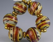 a set of 6 exotic rounds in goldstone purple and shades of brown handmade lampwork glass beads - Rio de Oro