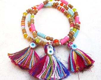 Tassel evil eye bracelet, beaded gemstone  bracelet, sandalwood stacking bracelet, african vinyl beads bracelet, bohemian elastic bracelet