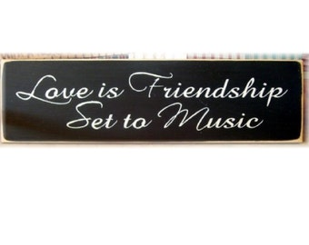 Love is friendship set to music primitive wood sign