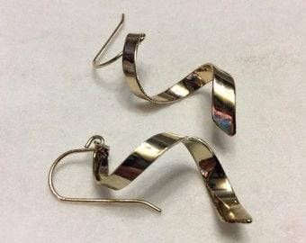 Gold metal spiral drop dangle pierced earrings.
