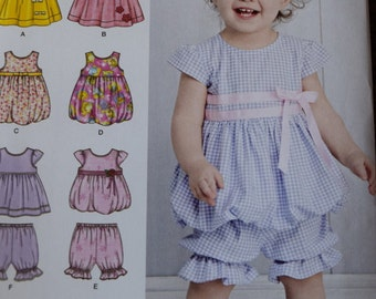 Simplicity 1141 Babie's Dress or Jumper, Top, Pantaloons and Bolero in sizes XXS-L (uncut)