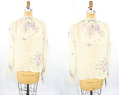 1970s blouse vintage 70s sheer beige floral print new with tags long sleeve bib top L/XL