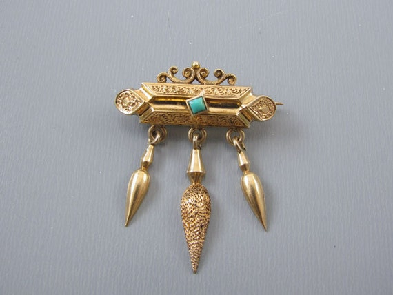 Antique mid Victorian 14k gold Etruscan Revival amphora tassel drop brooch pin with sugarloaf turquoise accent