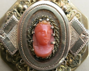 A Spectacular Vintage Layered Cameo Locket