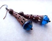 Dangle earrings with vivid peacock blue Czech glass beads and rusty metal cones
