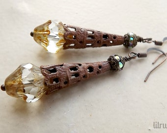 Dangle earrings with Czech glass crystals and rusty metal cones