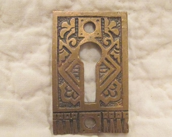 1 vintage brass key hole finding decorative