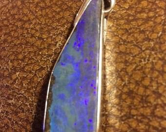 Glowing blue opal pendant
