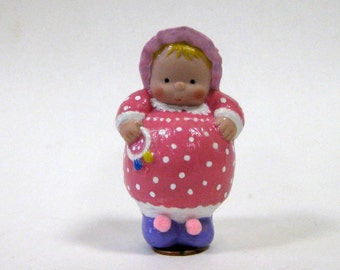 "Doll baby dumplin 3"" cast in white porcelain in pink polka dot dress"