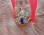 20% off sale Vintage 14KGE signed gold tone purple and clear rhinestone ring,condition is unworn, sizes 7 & 9
