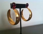 Large gold vintage hoops with red stone