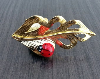 Leaf and ladybug ring, gold plated and lampwork bead