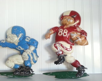 Three Football Metal Wall Hangings by Homeco Dated 1976 Made in the USA