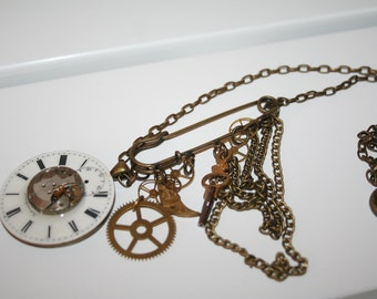 Steampunk watch face, watch movement, kilt pin, key and cogs necklace