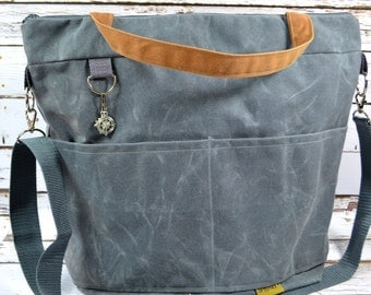Waxed Canvas diaper bags, by Darby Mack and made in the USA, vegan, waterproof & Lightweight - Grey and Cinnamon Nappy Sack