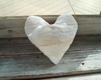 Ringbearer pillow in layers of vintage lace . back side burlap . white and ivory laces . heart ringbearer pillow