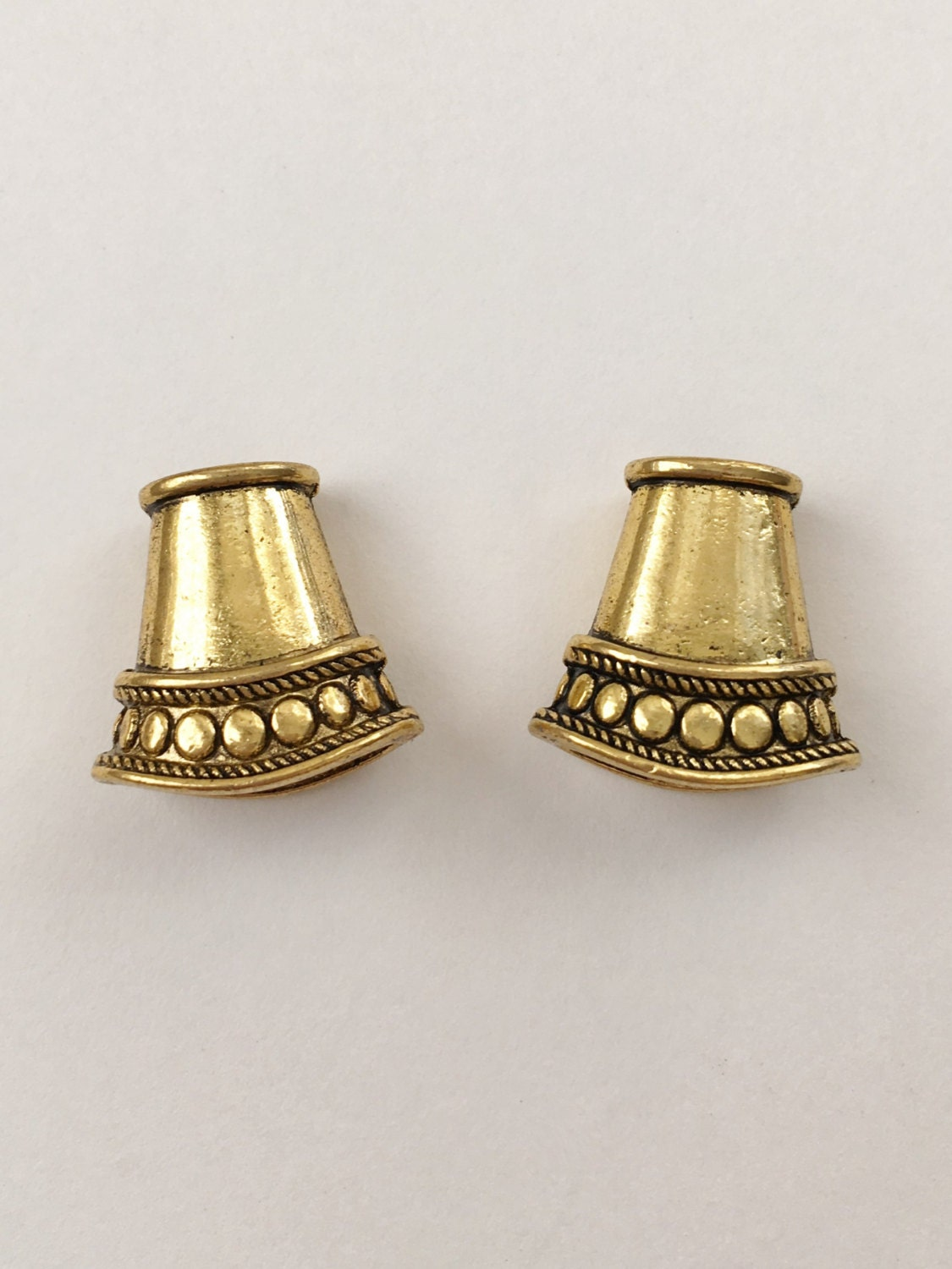 Antique gold cord ends end caps flattened cone shaped