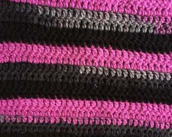 Pink and black striped blanket