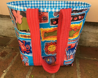Child's oilcloth tote bag on blue